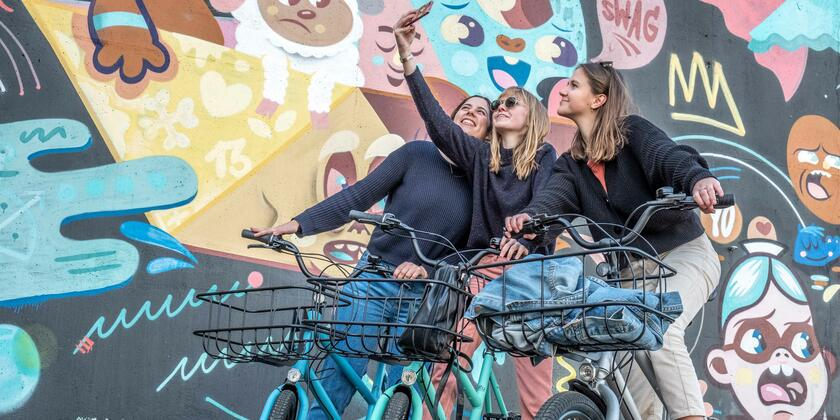 Friends on bikes taking a selfie