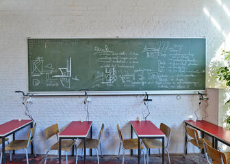 Interior of the restaurant with tables, chairs and a chalkboard
