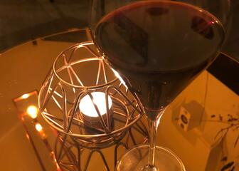 Wine glass and candle light