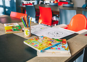 Children can colour or play during their visit