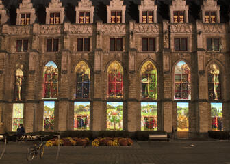 Modern version of the Ghent Altarpiece on the historic Cloth Hall in Ghent